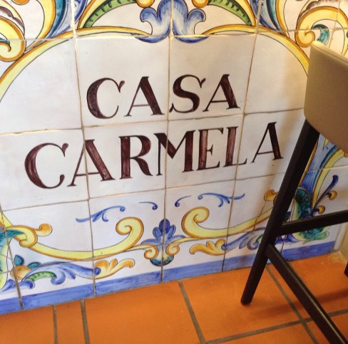 """A tiled sign reads """"Casa Carmela""""offering the name of the paella restaurant we enjoyed in Valencia Spain."""