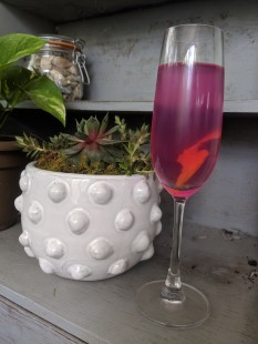 Alcoholic drink called the Violet 75.