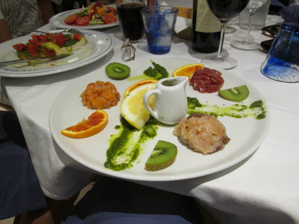 A plate of various fish tartare in Manarola, Italy.