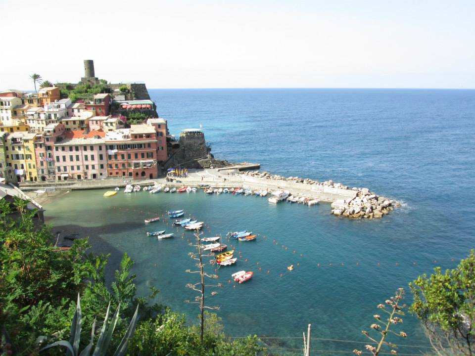 A view of the port in Vernazza showcasing the boats on the water.